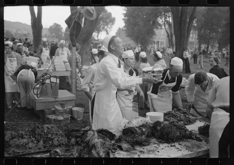 Carving the meats at the free Labor Day barbecue, Ridgway, Colorado, 1940