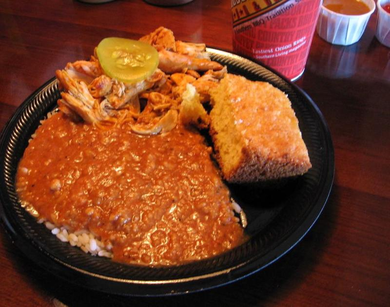 Hash and rice alongside mustard-dressed pork at Bessinger's Barbecue, Charleston, SC